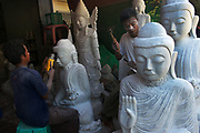 The town of Amarapura to the south of Mandalay is where the majority of Buddha statues are made in Myanmar (Burma), whether cast in bronze or sculpted from white marble quarried locally.
