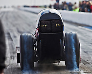 Champion Speed Shop Top Fuel Dragster during a burn out..The 2013 March Meet at the Auto Club Famoso Raceway in McFarland, CA.