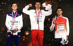 Poland's Marcin Lewandowski (centre), Norway's Jakob Ingebrigtsen (left), and Spain's Jesus Gomez with their medals at the Men's 1500m Final during day three of the European Indoor Athletics Championships at the Emirates Arena, Glasgow.