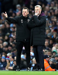 West Ham United manager David Moyes (right) and assistant Stuart Pearce (left) on the touchline during the Premier League match at the Etihad Stadium, Manchester.