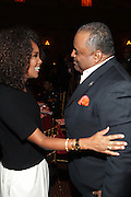New York, NY-October 5: (L-R) Television Producer Mara Brock Akil and On-Air Personality Roland Martin attend the ColorOfChange.org's 10th Anniversary Gala held at Gotham Hall on October 5, 2015 in New York City.  Terrence Jennings/terrencejennings.com