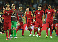 Football - European Championships 2012 - Portugal vs. Netherlands<br /> Christiano Ronaldo of Portugal celebrates with his team mates at the final whistle following their progression to the quarter finals at the Metalist Stadium, Kharkiv, Ukraine