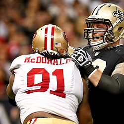 November 25, 2012; New Orleans, LA, USA; New Orleans Saints guard Eric Olsen (69) blocks San Francisco 49ers defensive end Ray McDonald (91) during the second half of a game at the Mercedes-Benz Superdome. The 49ers defeated the Saints 31-21. Mandatory Credit: Derick E. Hingle-US PRESSWIRE