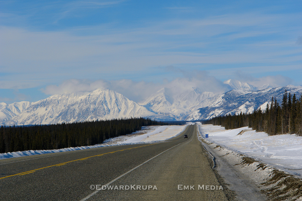 The Alaska Highway heading towards Haines Junction from Whitehorse, with the St. Elias mountains ahead. Yukon, Canada.