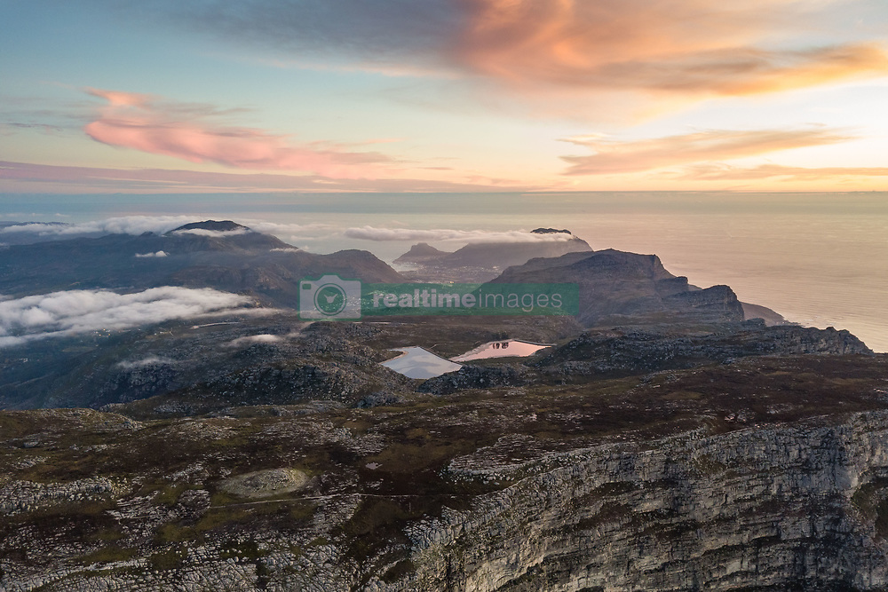 April 20, 2018 - Cape Town, Western Cape, South Africa - Aerial abstract view of Table Mountain at sunset, Cape Town, South Africa. (Credit Image: © Amazing Aerial via ZUMA Wire)