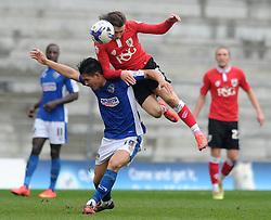 Bristol City's Luke Freeman challenges for the ariel ball with Oldham Athletic's Luke Woodland - Photo mandatory by-line: Dougie Allward/JMP - Mobile: 07966 386802 - 03/04/2015 - SPORT - Football - Oldham - Boundary Park - Bristol City v Oldham Athletic - Sky Bet League One