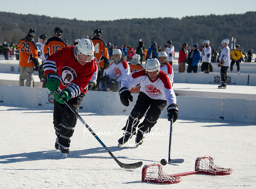 The Ice Sages take on the Off the Bench Hockey Club team in 50+ division Pool Play Saturday morning at New England Pond Hockey.  (Karen Bobotas/for the Laconia Daily Sun)