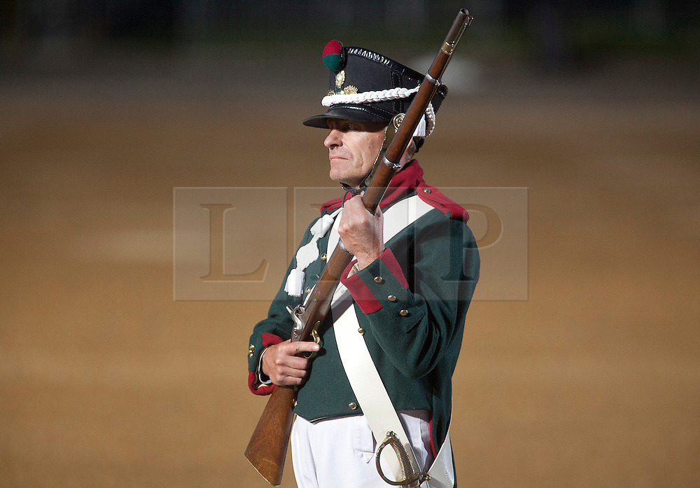 © Licensed to London News Pictures. 13/06/2012. LONDON, UK. A re-enactor of the 'Moscow Militia' stands ready to fire his musket during a performance of Tchaikowsky's '1812 Overture' at the annual Beating Retreat parade at Horse Guards Parade in London. On two successive evenings each year in June a pageant of military music, precision drill and colour takes place on Horse Guards Parade in the heart of London when the Massed Bands of the Household Division carry out the Ceremony of Beating Retreat. 300 musicians, drummers and pipers perform this age-old ceremony. The Retreat has origins in the early days of chivalry when beating or sounding retreat pulled a halt to the days fighting. Photo credit: Matt Cetti-Roberts/LNP