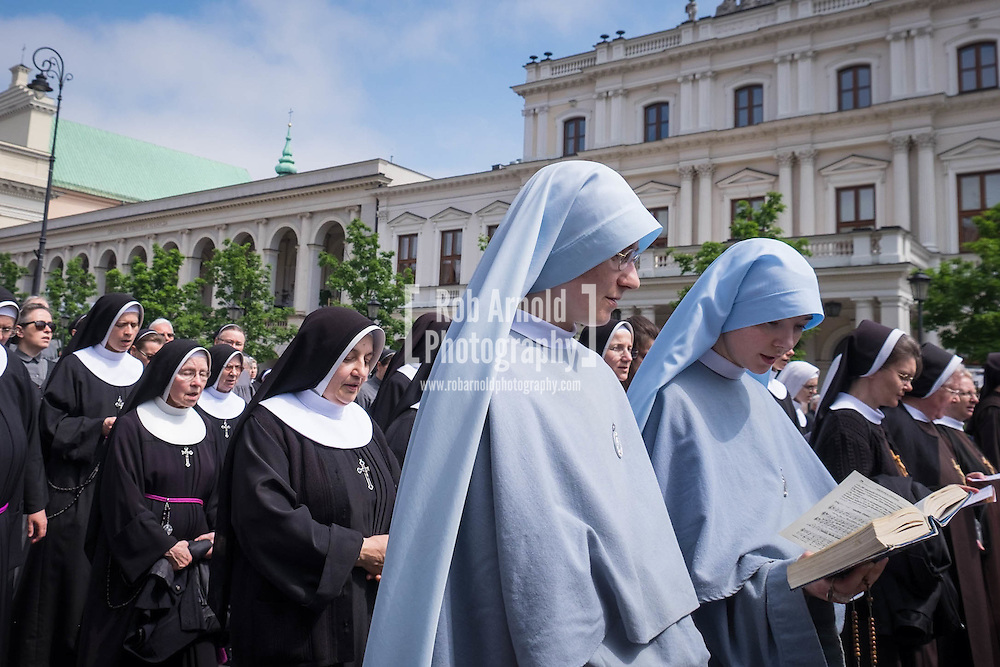 Nuns taking part in a procession through Warsaw's Old Town in commemoration Corpus Christi (Boze Cialo). Corpus Christi (Body of Christ) is a Catholic feast celebrated as a national public holiday in Poland. It is the day when the Catholic Church commemorates the practice of Holy Eucharist, or Communion.