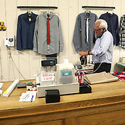 Tim Smith speaks on the phone to a customer at Lauber Clothing in Archbold, Ohio, on Wednesday, July 25, 2018. THE BLADE/KURT STEISS