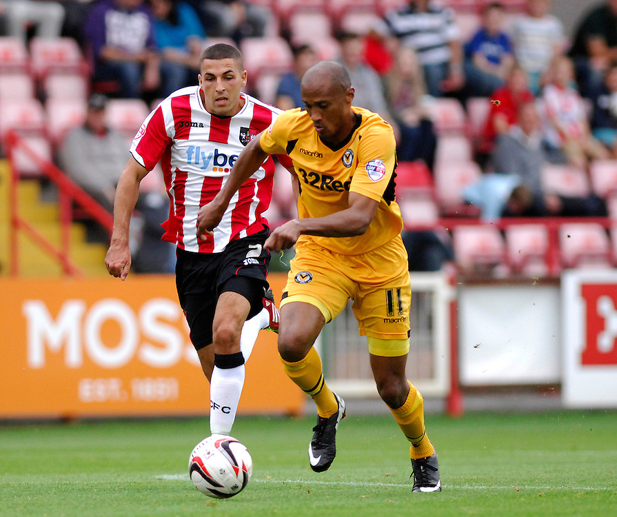 Exeter City's Liam Sercombe battles with Newport County's Chris Zebroski<br /> <br /> Photo by Ashley Crowden/CameraSport<br /> <br /> Football - The Football League Sky Bet League Two - Exeter City v Newport County - Saturday 21st September 2013 - St James Park - Exeter<br /> <br /> © CameraSport - 43 Linden Ave. Countesthorpe. Leicester. England. LE8 5PG - Tel: +44 (0) 116 277 4147 - admin@camerasport.com - www.camerasport.com