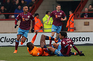 Scunthorpe United midfielder Duane Holmes (19) commits a foul  during the EFL Sky Bet League 1 match between Scunthorpe United and Oldham Athletic at Glanford Park, Scunthorpe, England on 3 March 2018. Picture by Mick Atkins.