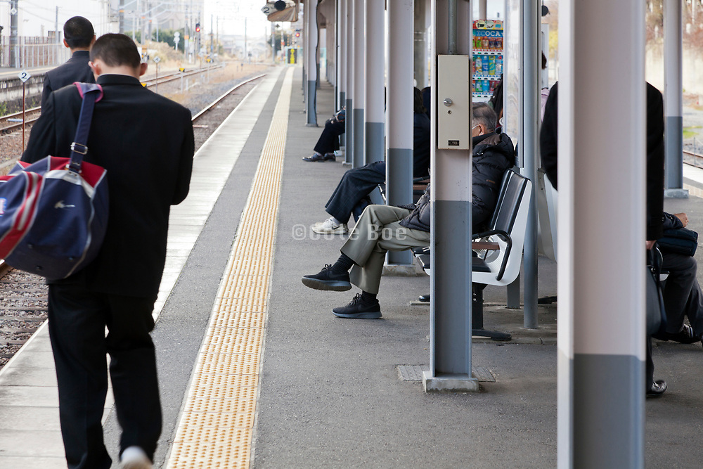 people waiting at a JR train platform near Nara Japan