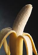 Close up studio photograph of a peeled banana