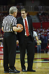 12 February 2011: referee Eric Curry and Tim Jankovich during an NCAA Missouri Valley Conference basketball game between the Missouri State Bears and the Illinois State Redbirds at Redbird Arena in Normal Illinois.