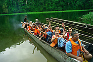 Tourists exploring Embera communities scattered along the Chagres River.