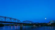 A rare supermoon coinciding with a solstice illuminates the Traffic Bridge on a warm summer evening.