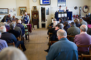 Neals auction rooms, Woodbridge, Suffolk, England people sitting as a sale is in progress.