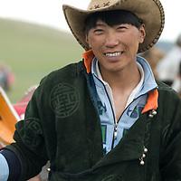 A rural herder at a naadam festival on a remote pass near Muren, Mongolia.