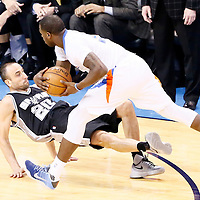 06 May 2016: Oklahoma City Thunder guard Dion Waiters (3) is called for a charging foul against San Antonio Spurs guard Manu Ginobili (20) during the San Antonio Spurs 100-96 victory over the Oklahoma City Thunder, during Game Three of the Western Conference Semifinals of the NBA Playoffs at the Chesapeake Energy Arena, Oklahoma City, Oklahoma, USA.