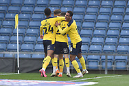 Oxford United players celebrate the first goal during the EFL Sky Bet League 1 match between Oxford United and Swindon Town at the Kassam Stadium, Oxford, England on 28 November 2020.