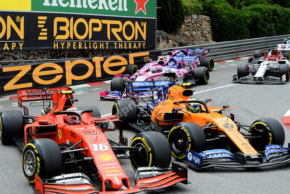 Charles Leclerc (Ferrari) side by side with Lando Norris (McLaren-Renault) in front of Lance Stroll and Sergio Perez (both Racing Point-Mercedes) during the 2019 Monaco Grand Prix. Photo: Grand Prix Photo