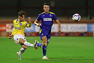 Brighton and Hove Albion striker Danny Cashman (51) crosses the ball from AFC Wimbledon midfielder Anthony Hartigan (8) during the EFL Trophy Southern Group G match between AFC Wimbledon and Brighton and Hove Albion U21 at The People's Pension Stadium, Crawley, England on 22 September 2020.