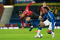 Football - 2020 / 2021 League Cup - Quarter-Finbal - Everton vs Manchester United - Goodison Park<br /> <br /> Manchester United's Alex Telles is tackled by Everton Alex Iwobi<br /> <br /> <br /> COLORSPORT/TERRY DONNELLY