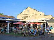 People outside the Riverside cinema, Woodbridge, Suffolk, England, UK on summer evening