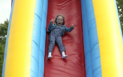 Savannah Phillips, daughter of Peter and Autumn Phillips, goes on a slide during the Royal Windsor Horse Show, which is held in the grounds of Windsor Castle in Berkshire.