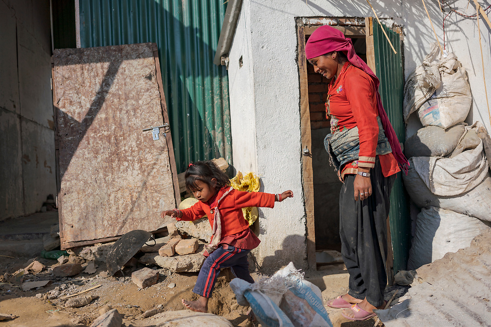 25 year-old Sapana Balami and her four year-old daughter, Aanchal Balami, now have access to a latrine near their home, Okharpauwa, Nuwakot District, Nepal