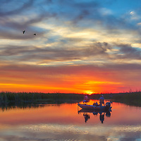 South Florida nature photography from outdoor photographer Juergen Roth showing a stunning sunset across Loxahatchee National Wildlife Refuge located west of Boynton Beach in Palm Beach County, FL. Arthur R. Marshall Loxahatchee National Wildlife Refuge is an amazing area for viewing wildlife and photography in Florida and also a popular fishing destination. <br />