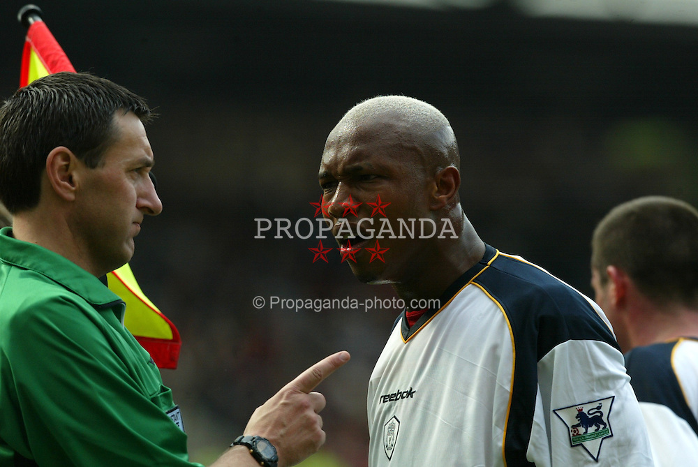 MANCHESTER, ENGLAND - Saturday, April 5, 2003: Liverpool's El-Hadji Diouf argues with a biased linesman against Manchester United during the Premiership match at Old Trafford. (Pic by David Rawcliffe/Propaganda)