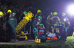 © Licensed to London News Pictures 19/01/2021.        Orpington, UK. The casualty has been recovered to the top of the river bank in a rescue stretcher. A person has been rescued from the River Cray in Orpington, South East London tonight (19.01.21) by The London Ambulance Hazardous Area Response Team along with firefighters from the London Fire Brigade.The condition of the person is unknown. Photo credit:Grant Falvey/LNP