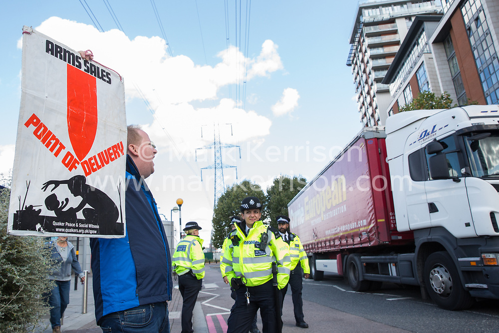 London, UK. 4 September, 2019. An anti-nuclear activist protests outside ExCel London as a truck passes on the third day of a week-long carnival of resistance against DSEI, the world's largest arms fair. The third day's protests were organised by the Campaign for Nuclear Disarmament (CND) and Trident Ploughshares.