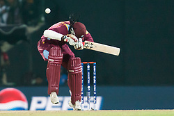 © Licensed to London News Pictures. 27/09/2012. West Indian Chris Gayle ducks a bouncer ball during the T20 Cricket World super 8's match between England Vs West Indies at the Pallekele International Stadium Cricket Stadium, Pallekele. Photo credit : Asanka Brendon Ratnayake/LNP