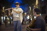 Boys dressed in traditional Israeli and Jewish clothes play the flute and mandolin on Ben Yahuda Street, Jerusalem, Israel