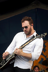 27 April 2012. New Orleans, Louisiana,  USA. .New Orleans Jazz and Heritage Festival. .British indie rock band Gomez plays the Gentilly stage. Ben Ottewell enjoys the gig..Photo; Charlie Varley.