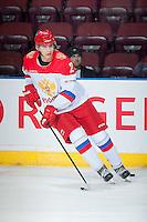 KELOWNA, CANADA - NOVEMBER 9: Ilya Kolganov # 2 of Team Russia warms up with the puck against the Team WHL on November 9, 2015 during game 1 of the Canada Russia Super Series at Prospera Place in Kelowna, British Columbia, Canada.  (Photo by Marissa Baecker/Western Hockey League)  *** Local Caption *** Ilya Kolganov;