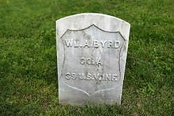 26 August 2017:   A part of the History of McLean County Illinois.<br /> <br /> Tombstones in Evergreen Memorial Cemetery.  Civic leaders, soldiers, and other prominent people are featured. Section 5, the old town soldiers area<br /> Wm. A Byrd  Co A  39 U.S. V INF