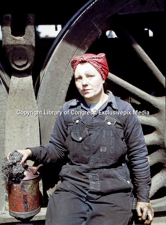 """Fascinating Color Portrait Photos of Women Railroad Workers During WWII<br /> <br /> World War II began when Hitler's army invaded Poland on September 1, 1939. However, it wasn't until the day after the Japanese attacked Pearl Harbor on December 7, 1941, that the United States declared war on the Axis Powers.<br /> <br /> The railroads immediately were called upon to transport troops and equipment heading overseas. Soon the efforts increased to supporting war efforts on two fronts-- in Europe and in the Pacific.<br /> <br /> Prior to the 1940s, the few women employed by the railroads were either advertising models, or were responsible primarily for cleaning and clerical work. Thanks to the war, the number of female railroad employees rose rapidly. By 1945, some 116,000 women were working on railroads. A report that appeared on the 1943 pages of Click Magazine regarding the large number of American women who had stepped forward to see to it that the American railroads continued to deliver the goods during the Second World War:<br /> <br />     """"Nearly 100,000 women, from messengers aged 16 to seasoned railroaders of 55 to 65, are keeping America's wartime trains rolling. So well do they handle their jobs that the railroad companies, once opposed to hiring any women, are adding others as fast as they can get them...""""<br /> <br /> In April 1943, Office of War Information photographer Jack Delano photographed the women of the Chicago & North Western Railroad roundhouse in Clinton, Iowa, as they kept the hulking engines cleaned, lubricated and ready to support the war effort.<br /> <br /> Photo shows: Mrs. Marcella Hart, mother of three, a wiper at the roundhouse.<br /> ©Library of Congress/Exclusivepix Media"""