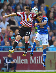 Sunderland's Lynden Gooch and Carlisle United's Mike Jones battle for the ball in the air