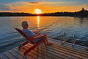 Fishing on dock on Star Lake at sunset<br />Whiteshell Provincial Park<br />Manitoba<br />Canada