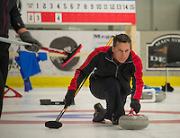 "Chris Miller from the ""Four Sheets to the Wind"" team launches his stone during Curling League play at the Plymouth State University Ice Arena on Thursday evening.  (Karen Bobotas/for the Laconia Daily Sun)"
