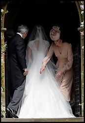 May 20, 2017 - London - Pippa Middleton wedding to James Matthews. The weeding of Pippa Middleton to James Matthews takes place at St.Mark's Church in Englefield, Berkshire, United Kingdom, The Duchess of Cambridge adjusts her sister's Pippa Middleton's wedding dress as they arrive at St.Mark's Church. (Credit Image: © i-Images via ZUMA Press)