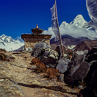 Prayer flags and chorten with Mounts Everest, Lhotse and Amadablam in the background.  Khumbu Region, Nepal 1980.