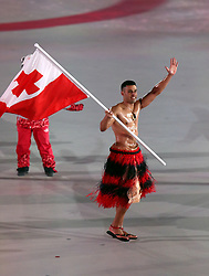 Tonga flag bearer Pita Taufatofua during the Opening Ceremony of the PyeongChang 2018 Winter Olympic Games at the PyeongChang Olympic Stadium in South Korea. PRESS ASSOCIATION Photo. Picture date: Friday February 9, 2018. See PA story OLYMPICS Ceremony. Photo credit should read: Mike Egerton/PA Wire. RESTRICTIONS: Editorial use only. No commercial use.