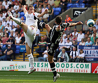 Photo: Paul Thomas. <br /> Bolton Wanderers v Newcastle United. Barclays Premiership. 11/08/2007. <br /> <br /> Heidar Helguson (L) of Bolton wins a header from Steven Taylor.