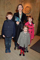 CAMILLA RUTHERFORD with her children Left to right, HECTOR ABBOTT, NANCY RUTHERFORD and MAUD ABBOTT at the opening night of Cirque du Soleil's award-winning production of Quidam at the Royal Albert Hall, London on 7th January 2014.