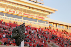 25 October 2014: The bronze battle bird stands in the north end zone in the shadows of Renovated Hancock Stadium lit by the golden afternoon light during an NCAA Missouri Valley Conference game between the Missouri State Bears and the Illinois State Redbirds at Hancock Stadium in Normal, Illinois.